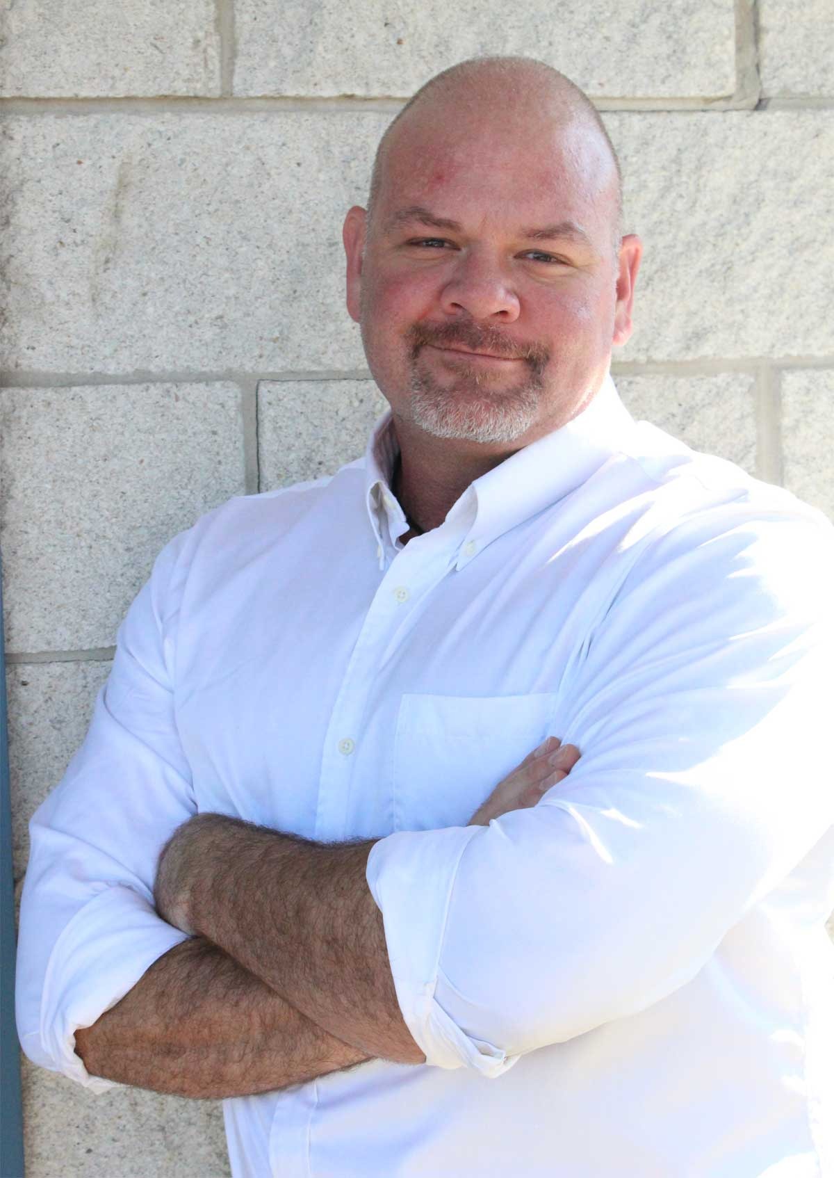 Steve Green, JD MBA, Founding Partner standing with his arms crossed wearing a white shirt on the Archangel Law Group website homepage