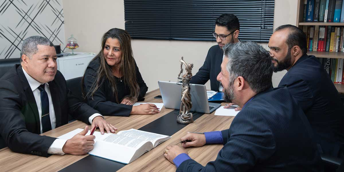 A group of business people at a conference table negotiating for Business Law on the Archangel Law Group website homepage