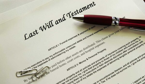 Last Will And Testament With Pen And Paper Clips On The Arch Angel Law Group Blog Do I Need A Will
