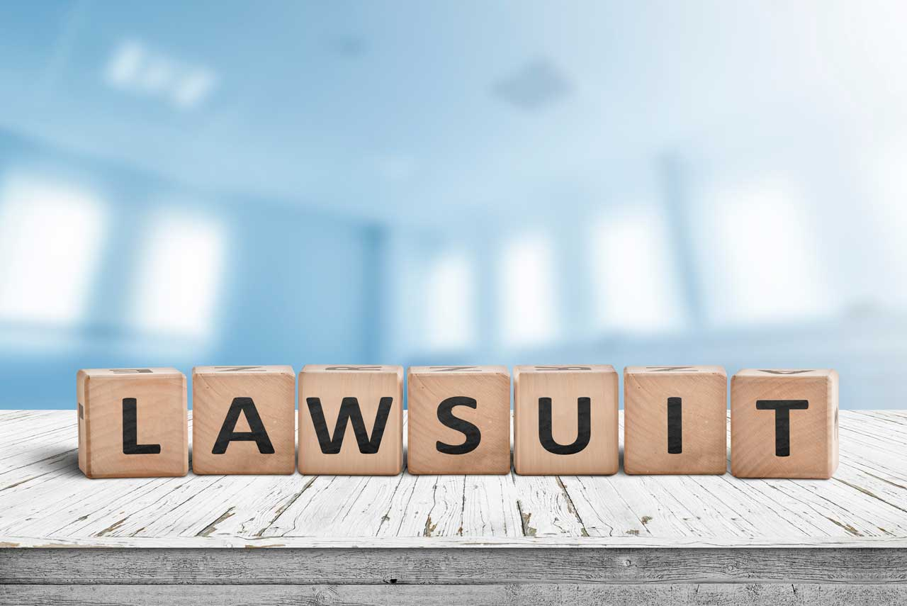The Word Lawsuit Spelled Out In Blocks For Being Sued