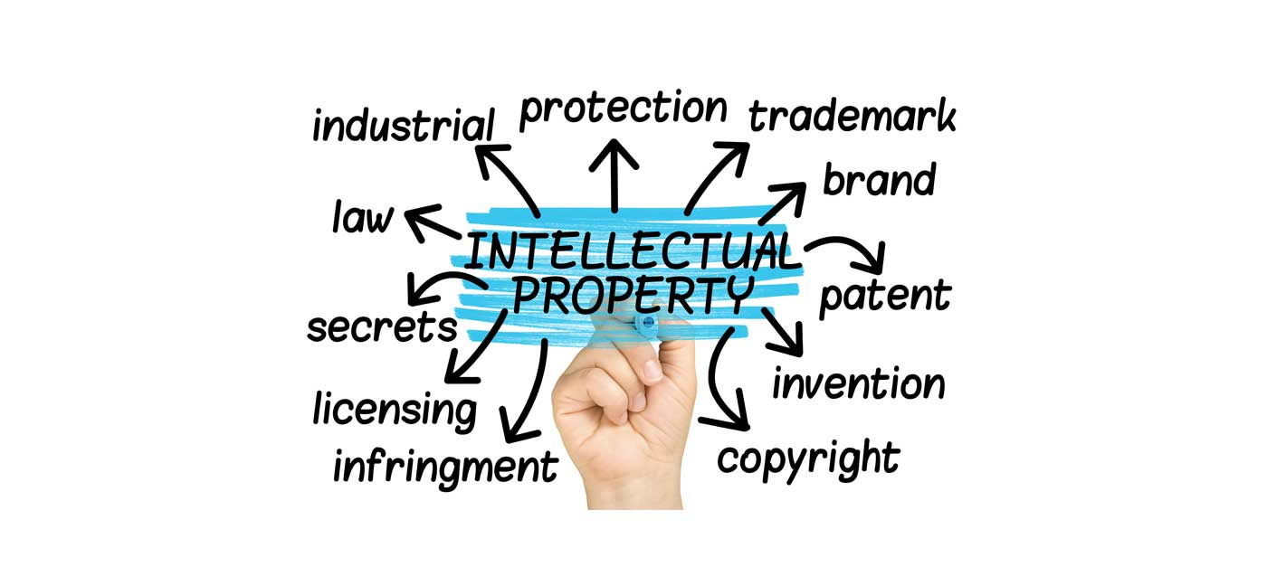 Set up a new business graphic showing a hand writing intellectual property and other elements needed